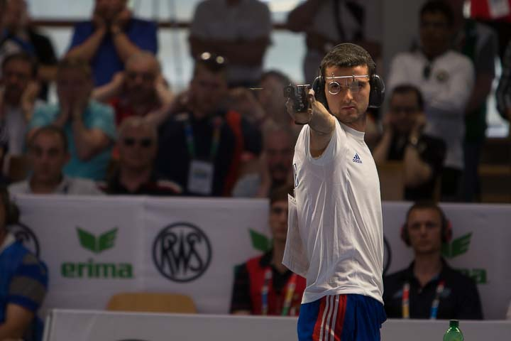 MUNICH - JUNE 10: 5th placed Clement BESSAGUET of France competes in the 25m Rapid Fire Pistol Men Finals at the Olympic Shooting Range Munich/Hochbrueck during Day 5 of the ISSF World Cup Rifle/Pistol/Shotgun on June 10, 2014 in Munich, Germany. (Photo by Wolfgang Schreiber)